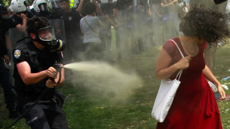 Shower of pepper spray turns woman in a red dress into Turkeyís image of resistance